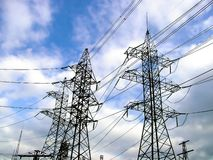 Electrical pylons. On blue sky background Stock Image