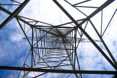 Electrical pylons. Against blue sky Stock Image