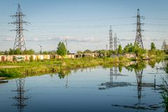 Electrical pylons with cables going into the distance. royalty free stock photography