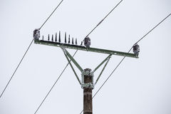 Electrical pylons high voltage wires in winter covered snow and. Ice Stock Photography