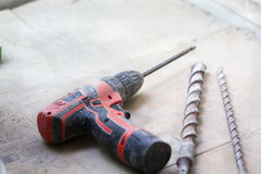 Electrical renovation work, Percussion drill. Electrical renovation work Cable Electric.Percussion drill on a cement floor Royalty Free Stock Images
