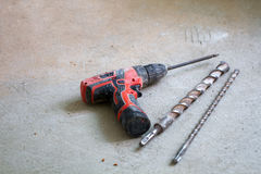 Electrical renovation work, Percussion drill. Electrical renovation work Cable Electric.Percussion drill on a cement floor Stock Images