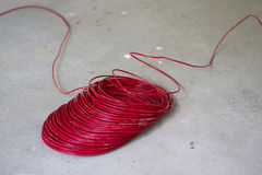 Electrical renovation work, Red  electric wire. Electrical renovation work, Red electric wire On the cement floor Stock Images