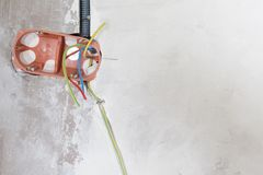 Electrical renovation work wiring in pipe wall. Electrical renovation work wiring in pipe white plaster wall royalty free stock photography
