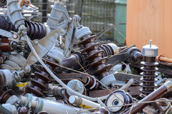 Electrical scrap with insulators and electric coils Stock Photos