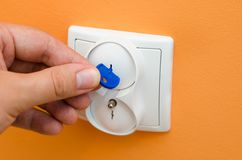 Electrical security plugs for baby and child safety Royalty Free Stock Photos