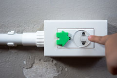 Electrical security for safety home of ac power outlet for babies, baby hands playing with electric plug. Electrical security for safety home of ac power outlet royalty free stock photography