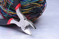 Electrical service, component tool and wires. On metal background Stock Image