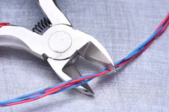 Electrical service, component tool and wires. On metal background Royalty Free Stock Photo