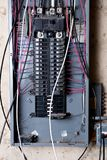 Electrical service panel and branch circuit wiring. In the basement of house under remodeling Royalty Free Stock Image