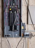 Electrical service panel and branch circuit wiring. In the basement of house under remodeling Stock Photography