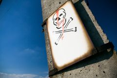 Electrical skull sign on pylon Stock Photo