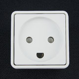 Electrical socket on black background. White electrical connector on black background Royalty Free Stock Images