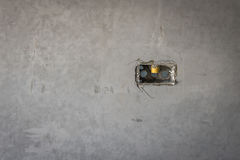 Electrical socket hole on precat concret wall, outlet electric w. Ires in constuction site royalty free stock photography