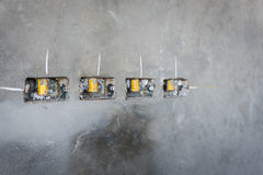Electrical socket hole on precat concret wall, outlet electric w. Ires in constuction site stock images