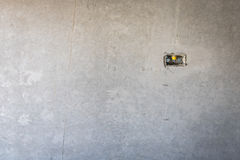 Electrical socket hole on precat concret wall, outlet electric w. Ires in constuction site royalty free stock images