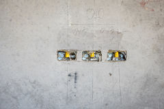 Electrical socket hole on precat concret wall, outlet electric w. Ires in constuction site royalty free stock photo