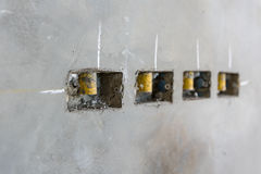 Electrical socket hole on precat concret wall, outlet electric w. Ires in constuction site stock photo