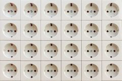 Electrical socket outlets texture. Many electrical socket outlet swhite colors royalty free stock photography