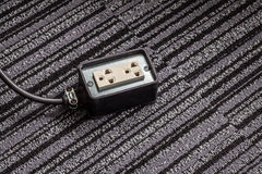 Electrical socket with power plug cable on carpet floor for safe Stock Photo