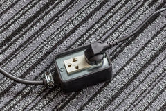 Electrical socket with power plug cable on carpet floor for safe Royalty Free Stock Photo