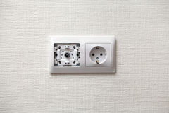 An electrical socket and TV outlet on wall. In the room royalty free stock photos