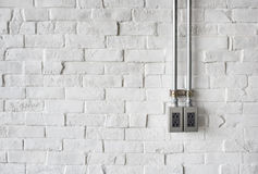 Electrical Socket on a White Painted Brick Wall Stock Image