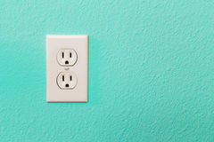 Electrical Sockets In Colorful Bright Teal Wall Royalty Free Stock Photography