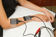 Electrical stimulation forearm Stock Photo