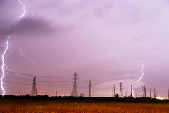 Electrical Storm Thunderstorm Lightning over Power Lines South T Royalty Free Stock Photography