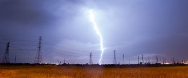 Electrical Storm Thunderstorm Lightning over Power Lines South T Royalty Free Stock Photo