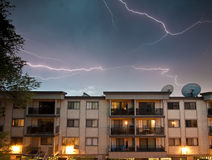Electrical Storm in Urban Area. An electrical storm overhead an urban area Stock Image