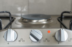 Electrical stove knob with light on Stock Image