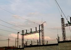 Electrical substation. The backs of the electric substation in the city at sunset stock image