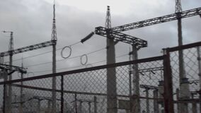 Electrical substation, behind the fence, natural light