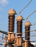 Electrical Substation Insulators. And blue sky in the background Royalty Free Stock Photo