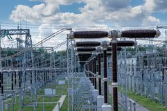 Electrical substation 330 kV, a series of high-voltage switches. Electrical substation 330 kV, a series of high-voltage switches, goes into the distance blue royalty free stock photos