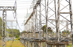 Electrical substation poles and wires summer Royalty Free Stock Images