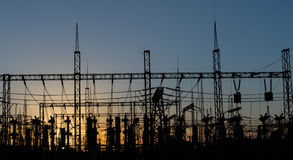 Electrical substation silhouette on the dramatic sunset background. Royalty Free Stock Photography