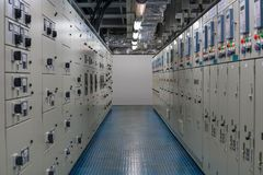 Electrical switch gear room located in hazardous area with positive pressure, electrical switch board of high voltage and low. Voltage systems to control oil royalty free stock photography