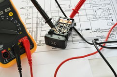Electrical switch and multimeter Stock Photography