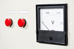 Electrical switch panel with button and voltmeter Royalty Free Stock Photos