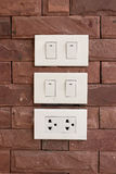 Electrical switches mounted on the wall. Three Electrical switches mounted on the wall Stock Photo