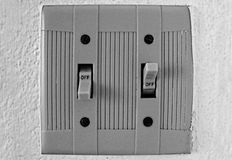 Electrical switches off-off. Abstract, electrical switches off-off  on a white wall Stock Photography