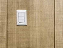 Electrical switches on plywood wall royalty free stock images