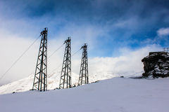 The electrical system on a snow mountain Stock Photo