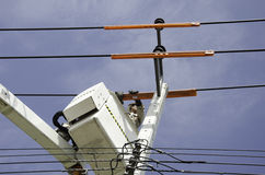 Electrical technician. The crane technicians are repairing wires Stock Image