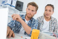 Electrical technicians at work stock photography