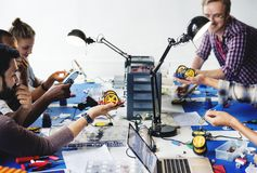 Electrical technicians working on robot electronics parts stock photography