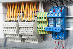 Electrical terminal blocks on bar Royalty Free Stock Image